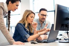 stock image of  group of business people and software developers working as a team in office