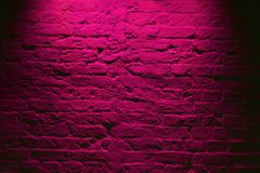 stock image of  grunge neon pink brick wall texture background. magenta colored brick wall texture architecture pattern