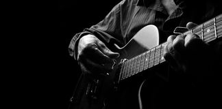stock image of  guitarist hands and guitar close up. playing electric guitar. play the guitar. copy spaces.