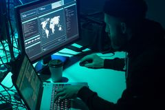 stock image of  hackers making cryptocurrency fraud using virus software and computer interface. blockchain cyberattack, ddos and
