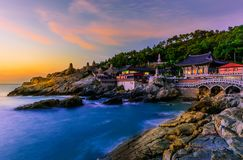 stock image of  temple and sunrise in busan city in south korea.