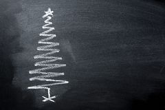 stock image of  hand drawn doodle christmas tree chalk blackboard in spiral form. new year greeting card poster banner