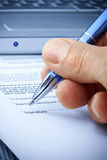 stock image of  hand signature computer contract insurance