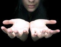 stock image of  hands in darkness