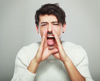 stock image of  handsome man yelling