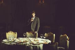 stock image of  handsome man drinks wine