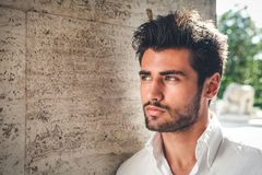 stock image of  handsome young man portrait. intense look and eye-catching beauty