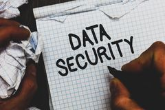 stock image of  handwriting text data security. concept meaning confidentiality disk encryption backups password shielding man holding marker note