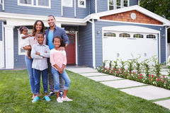 stock image of  happy black family standing outside their house