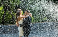 stock image of  happy bride and groom. cheerful married couple. just married couple embraced. wedding couple