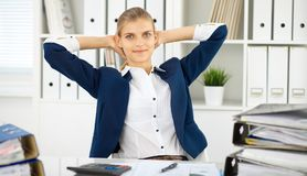 stock image of  happy business woman or female accountant having some minutes for coffee and pleasure at working place