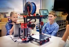 stock image of  happy children with 3d printer at robotics school