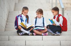 stock image of  happy children girlfriend schoolgirl student elementary school