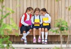 stock image of  happy children girlfriends schoolgirls student elementary schoo