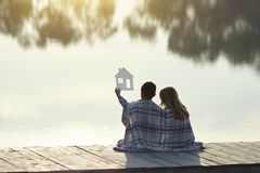 stock image of  happy couple of kids dream of a home