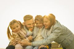 stock image of  happy family outdoor.