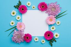 stock image of  happy mother`s day, women`s day, valentine`s day or birthday pastel candy colours background. floral flat lay greeting card