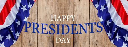 stock image of  happy presidents` day text on wooden with flag of the united states border