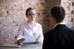 stock image of  happy woman hr manager with resume looking at job seeker.