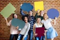 stock image of  happy young adults holding empty placard thought bubbles copyspa