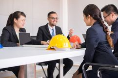 stock image of  hard hats safety helmet in meeting room,blured of people architect and engineer at office