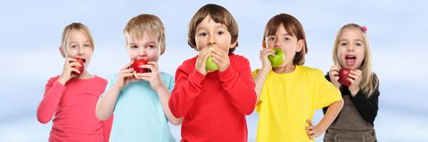 stock image of  healthy eating group of kids children apple fruit copyspace banner