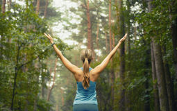 stock image of  healthy lifestyle fitness sporty woman early in forest area