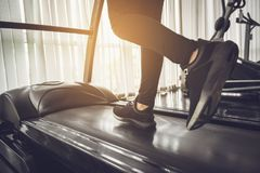 stock image of  healthy people running on machine treadmill at fitness gym
