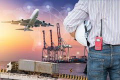 stock image of  heavy industry of cargo ship terminal and logistics transportation, air freight, sea freight, business industrial concept