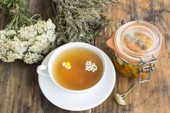 stock image of  herbal medicine, tea, yarrow, savory, chamomile and calendula oi