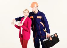stock image of  high bills concept. repairer get salary for work.