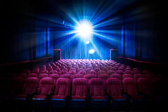 stock image of  high contrast image of empty movie theater seats
