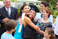 stock image of  hispanic student and family celebrating graduation