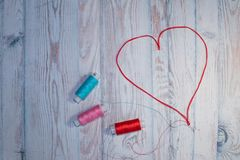 stock image of  hobbies and crafts concept, heart of red threads