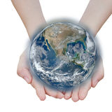 stock image of  holding a glowing earth globe .elements of this image
