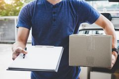stock image of  home delivery service and working with service mind, deliveryman with boxes standing by in front of the customer house doors and