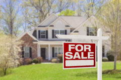 stock image of  home for sale real estate sign and house