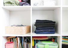 stock image of  home wardrobe with different clothes. small space organization. the contrast of order and disorder
