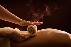 stock image of  hot towel compress. spa treatment
