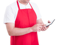 stock image of  hypermarket merchandiser with tablet pc at work