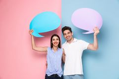 stock image of  image of optimistic couple holding copyspace commercial bubbles