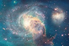 stock image of  incredibly beautiful galaxy somewhere in deep space. science fiction wallpaper