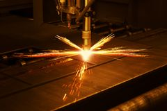 stock image of  industrial cnc plasma machine cutting of metal plate