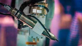stock image of  industrial mechanical robot manufacturing line