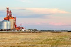 stock image of  inland grain storage terminal in the summer evening after harvest