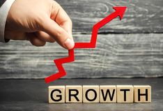stock image of  the inscription growth and up arrow. the concept of a successful business. increase in income, salary. the growth of the company`
