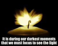 stock image of  inspirational motivational quote, life wisdom - it is during our darkest moments that we must focus to see the light