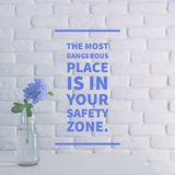 stock image of  inspirational quote `the most dangerous place is in your safety zone`