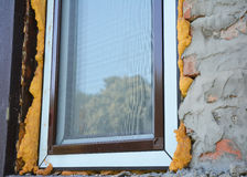 stock image of  install window insulation with foam. a mosquito windows net offers protection.