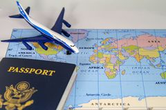 stock image of  international map, passport and commercial jet airplane.